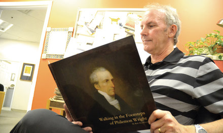 {Local author pens history book}